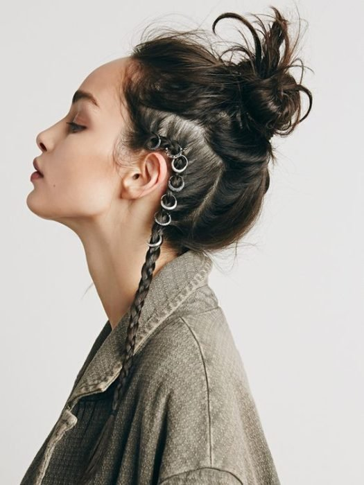 girl with bun hairstyle and side braid with hoops
