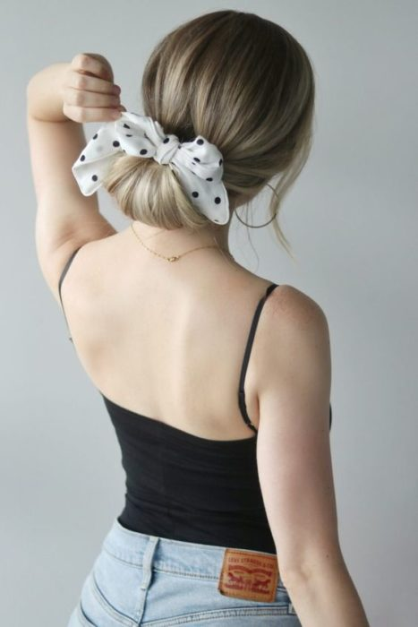 girl with a low bun and a scarf bow