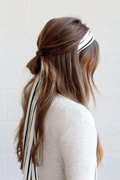 girl with half ponytail and scarf