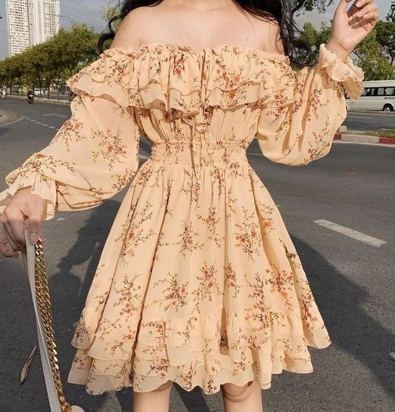 Low Shoulder Yellow Dress With Ruffles And Orange Flower Print
