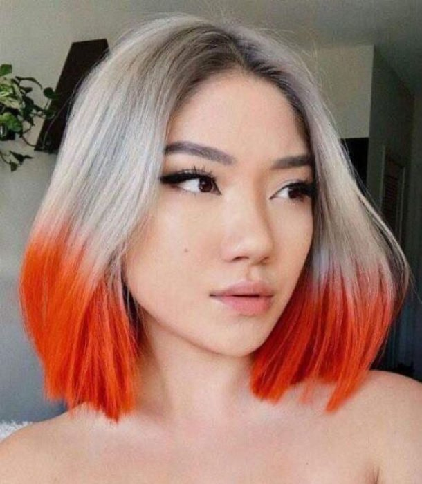 Girl with dyed platinum hair with orange tips