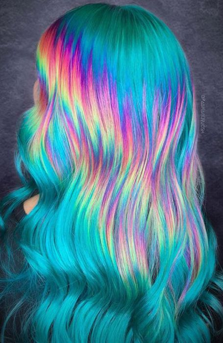 Girl with hair dyed in blue and different colors of the rainbow