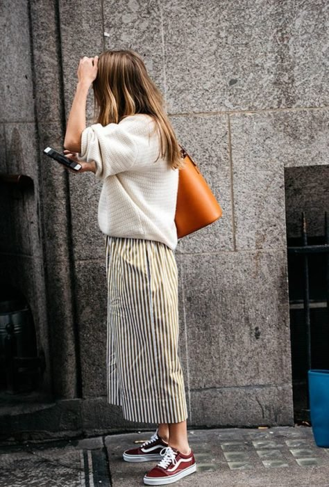Girl wearing loose white sweater and long maxi skirt