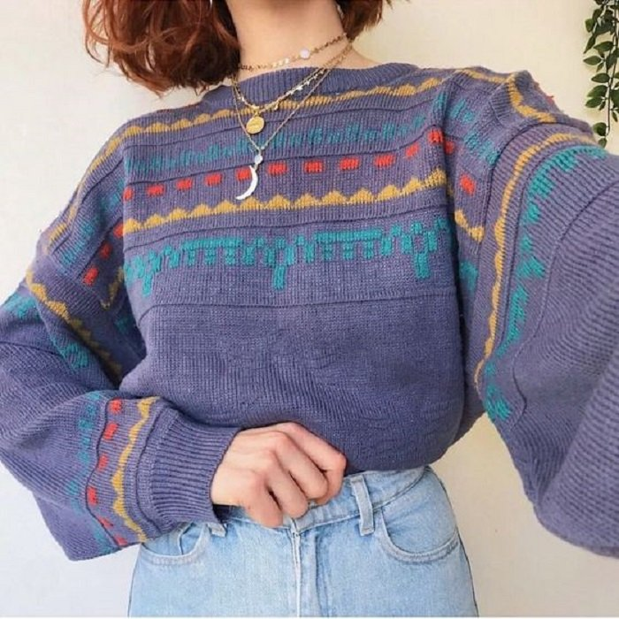 Lilac autumnal colored sweater with blue, yellow and red details