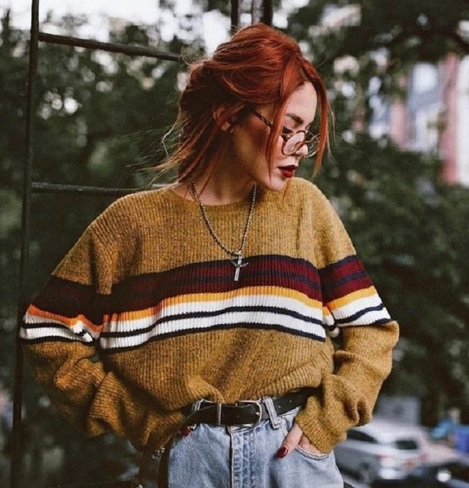 Autumn colored sweater in moztard color, with black, white, cherry and yellow lines