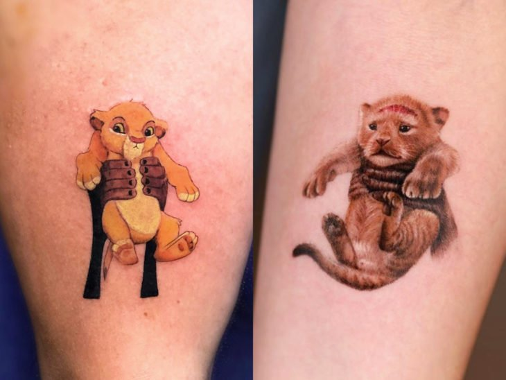 Disney tattoo on the arm, The lion king, Rafiki carrying Simba