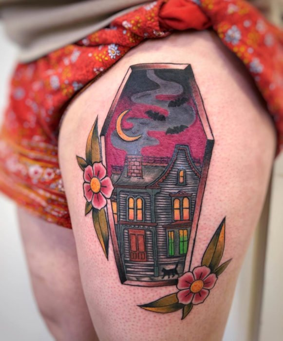 Tattoos from the witch movie Hocus Pocus; haunted house tattoo on leg