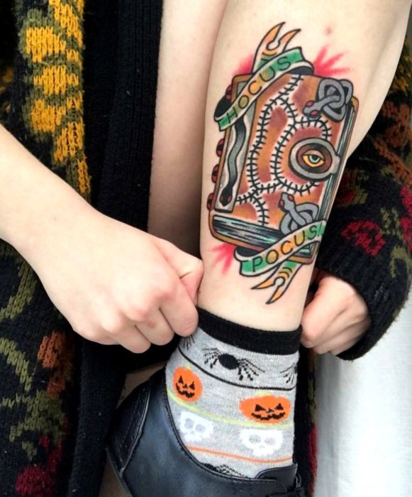 Tattoos from the witch movie Hocus Pocus; spell book tattoo on leg