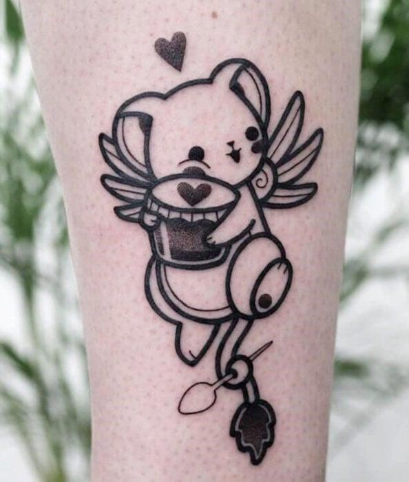 Sakura Card Captor tattoo on arm, Kero in contour lines hugging food