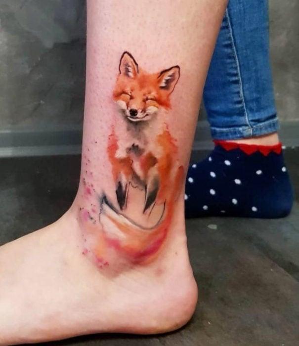 Pretty watercolor tattoo designs; Fox tattoo on leg, ankle