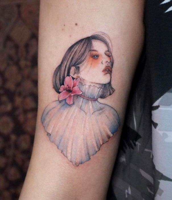 Pretty watercolor tattoo designs; woman tattoo on arm