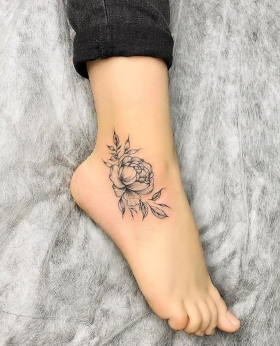 Flower, rose tattoo on ankle