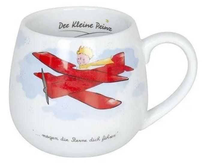 Taza inspirada en El Principito, en donde se ve al Principito en la avioneta roja