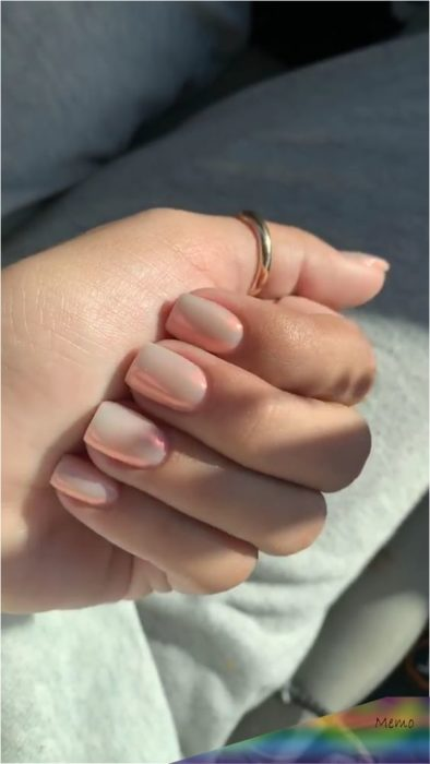 Manicure design on short nails on nunde background with iridescent areas