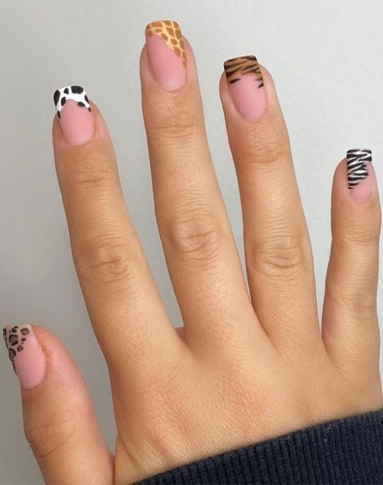 Manicure in animal print design in colors with the tip in different designs of each animal
