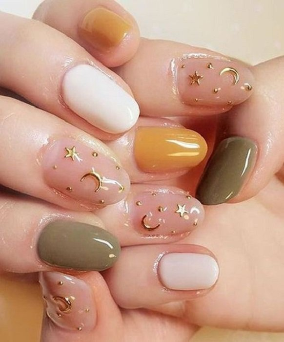 Mustard Manicure with Green, White and Gold Star Details