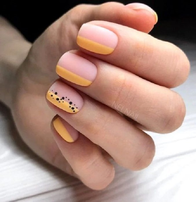 Manicure design on short nails on nude and yellow background with black details