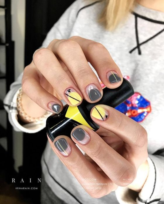 Manicure design on short nails in yellow, gray and black