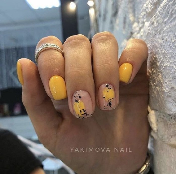 Mustard color manicure with nude details and black dots