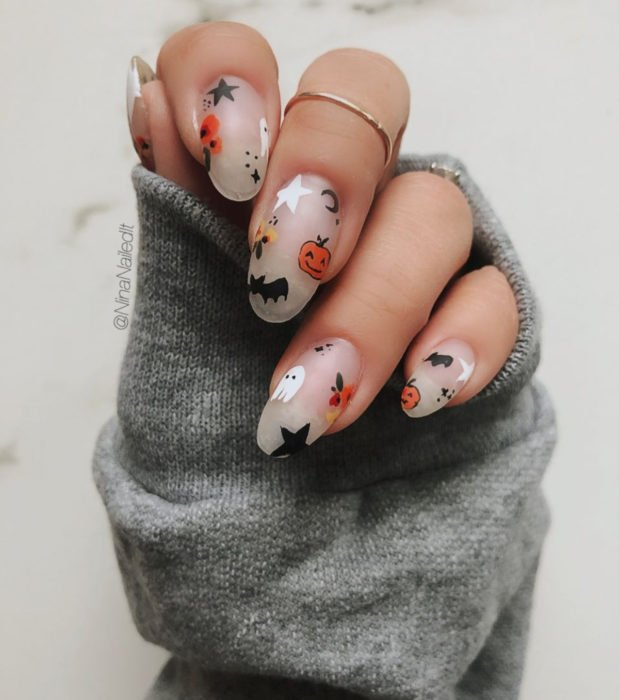 Halloween cute, kawaii long almond nail designs in pastel color; bats, pumpkins, ghosts and stars