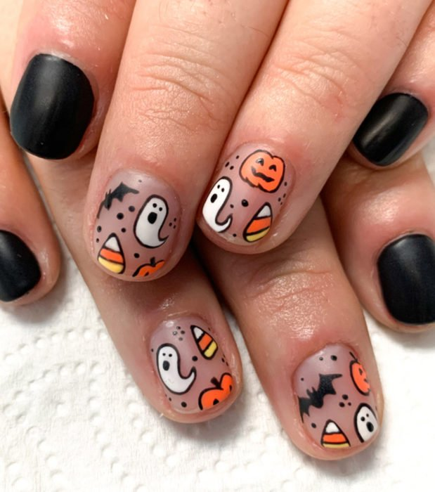 Kawaii, cute Halloween short nail designs in pastel and black; ghosts, bats, candy and pumpkins