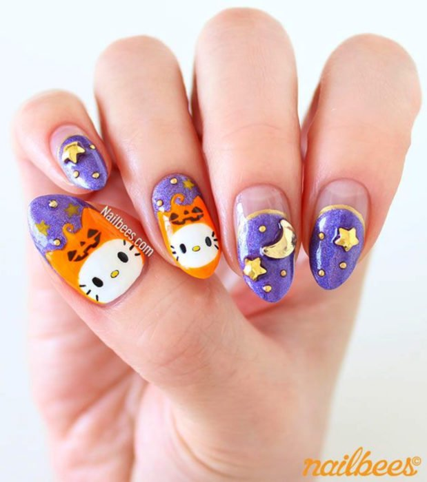 Cute Halloween kawaii stiletto nail designs in pastel and purple colors; Hello Kitty with pumpkins, moons and stars