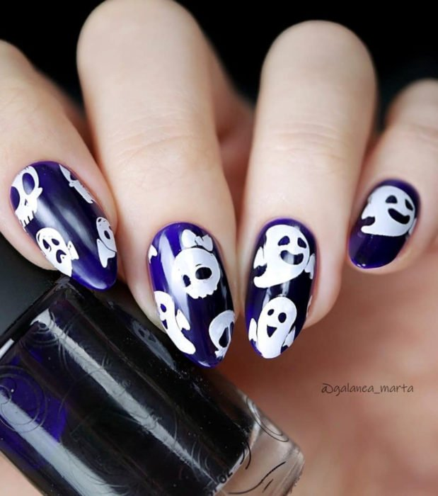 Cute Halloween Kawaii Almond Long Nail Designs in Pastel and Purple; ghosts and skull with bow