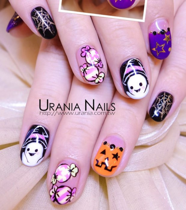 Kawaii, cute Halloween short nail designs in pastel pink, black and purple; ghosts with witch hats, pumpkins, cobwebs and candy