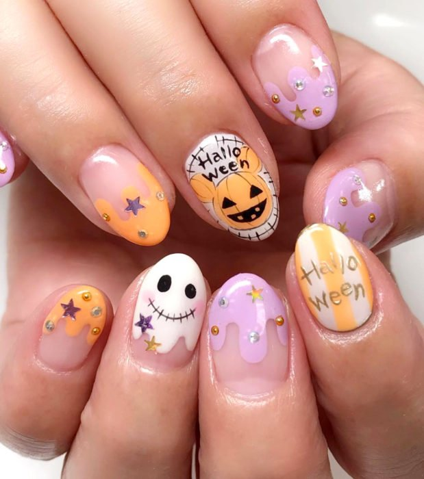 Kawaii, cute nail designs in pastel Halloween color; almond, pumpkins, ghosts and Mickey Mouse