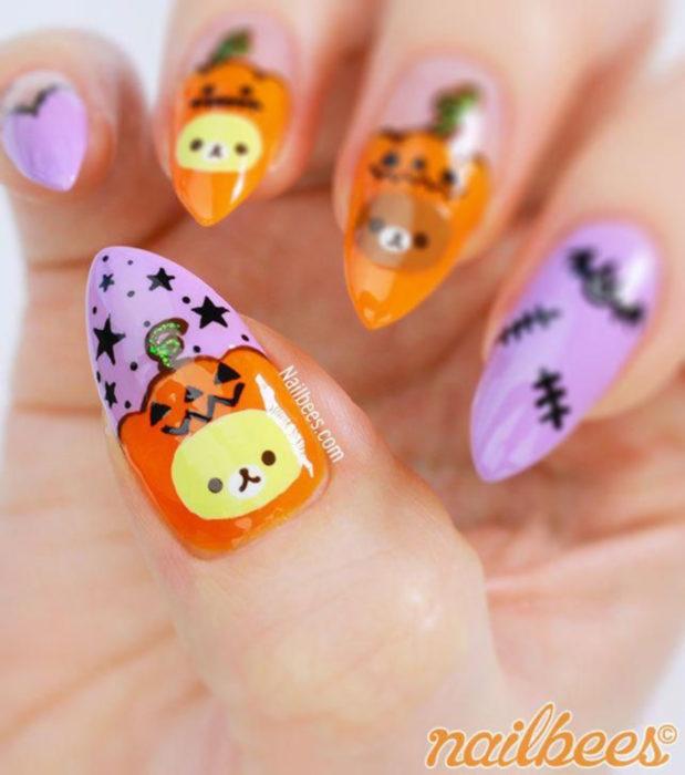 Diseños de uñas kawaii, tiernas en color pastel de Halloween; calabazas y murciélagos