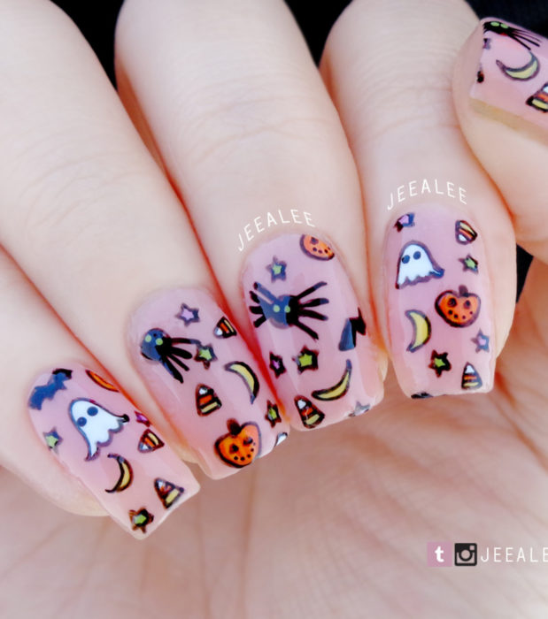 Cute, kawaii square long nail designs in pastel Halloween color; ghosts, bats, pumpkins, moons and candy