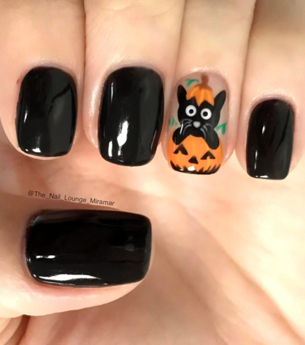 Cute, kawaii short square nail designs in Halloween black color; cat with pumpkin