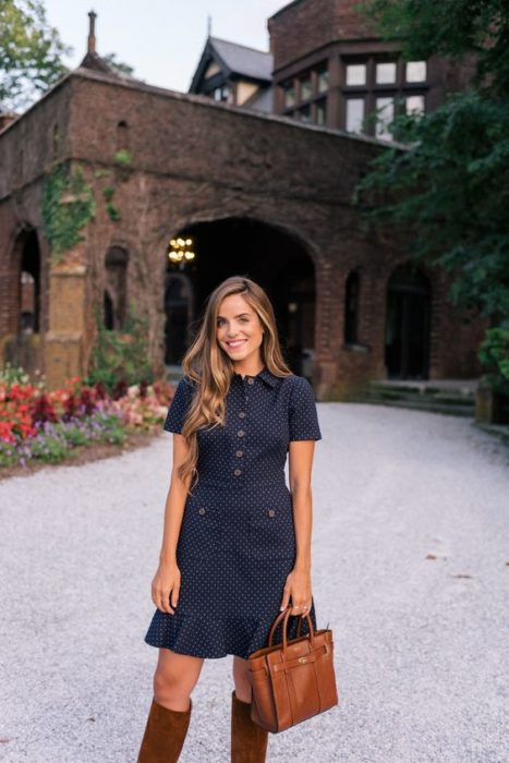 Long brown hair girl in navy blue dress with buttons in front and brown boots