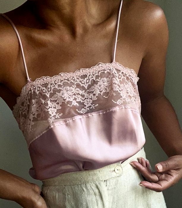 Lilac strappy blouse with lace, beige dress pants at the waist with glitter