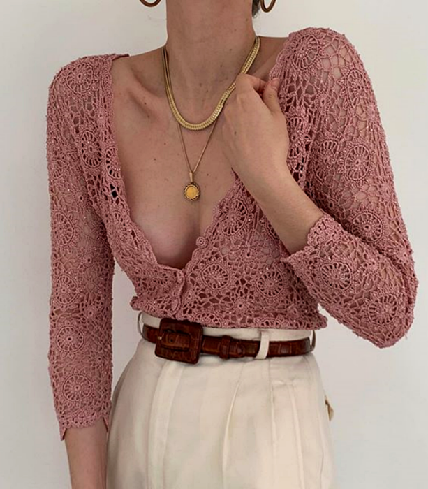 Pink V-neck long sleeve lace blouse with buttons, brown leather belt, white dress waist pants and gold necklaces