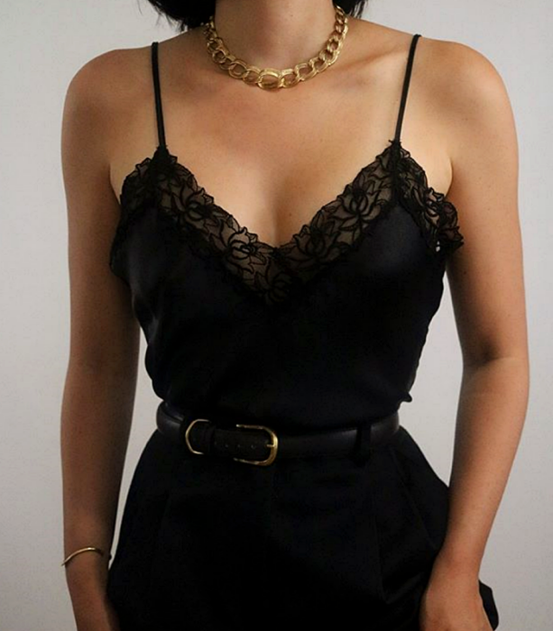 black tank top with black lace, black leather belt, black waist dress pants and gold link necklace