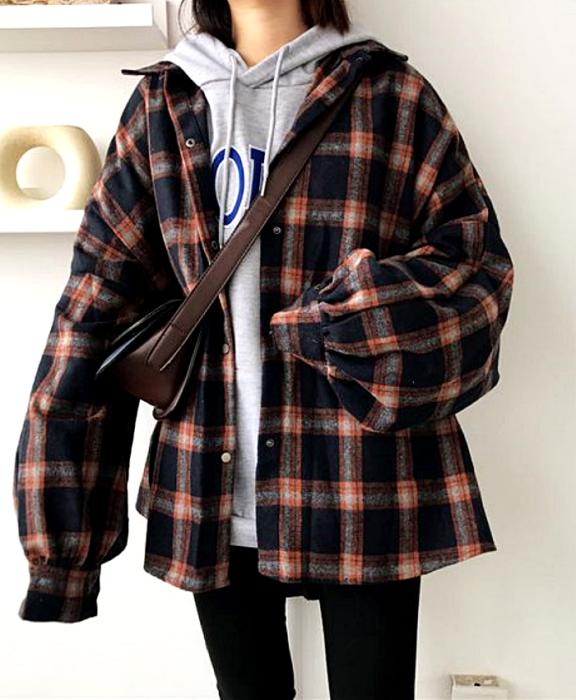 brown haired girl wearing gray sweatshirt, blue plaid coat, leggings and brown bag