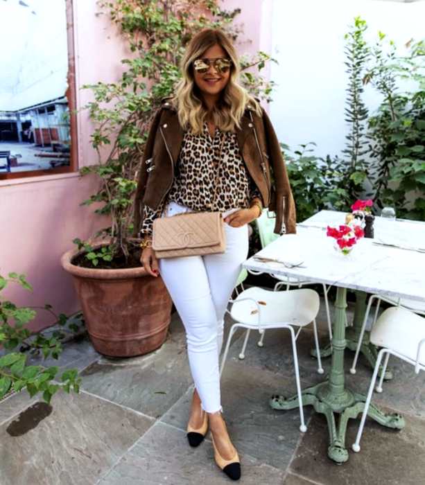 Curvy blonde sunglass girl wearing animal print blouse, brown corduroy jacket with beige chanel bag, white skinny jeans and beige flats with black tip