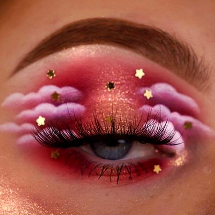 maquillaje de ojos con sombreado rosa, naranja, rojo, guinda y blanco con nubes y estrellitas