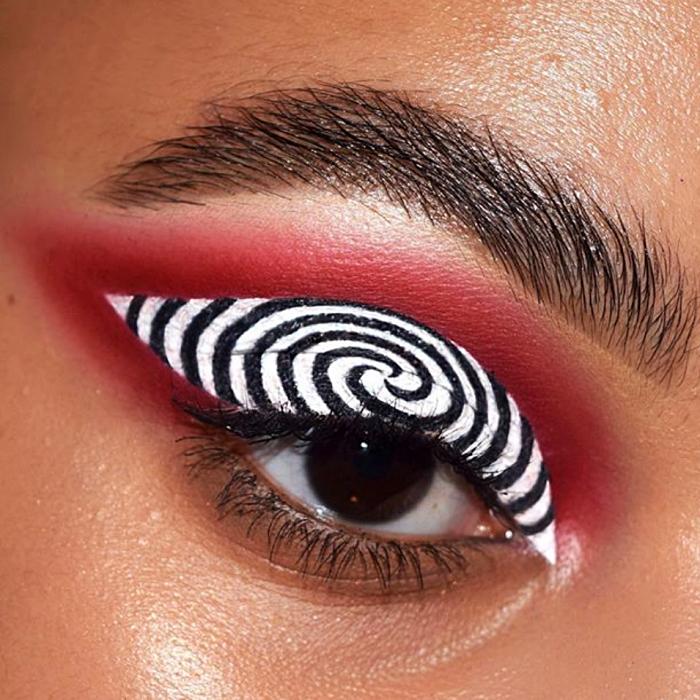 maquillaje blanco y negro con espiral negro y sombreado guinda