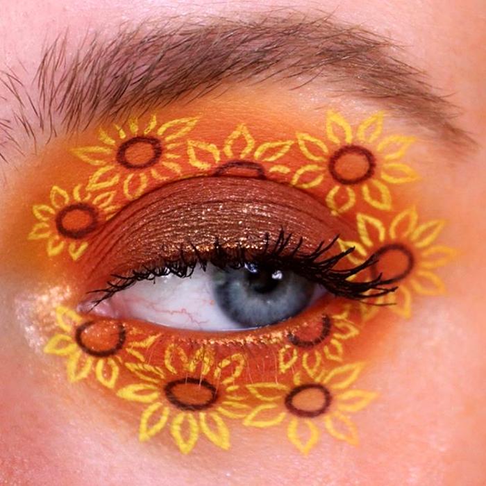 maquillaje de ojos con sombreado naranja y amarillo y dibujos de girasoles amarillos con naranja