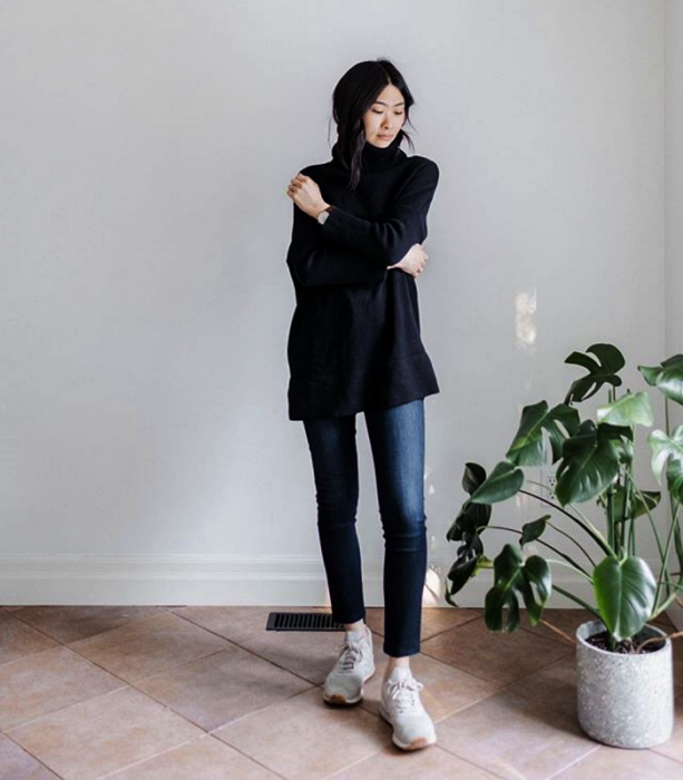 dark long hair girl wearing black oversized sweater, skinny jeans and white sneakers