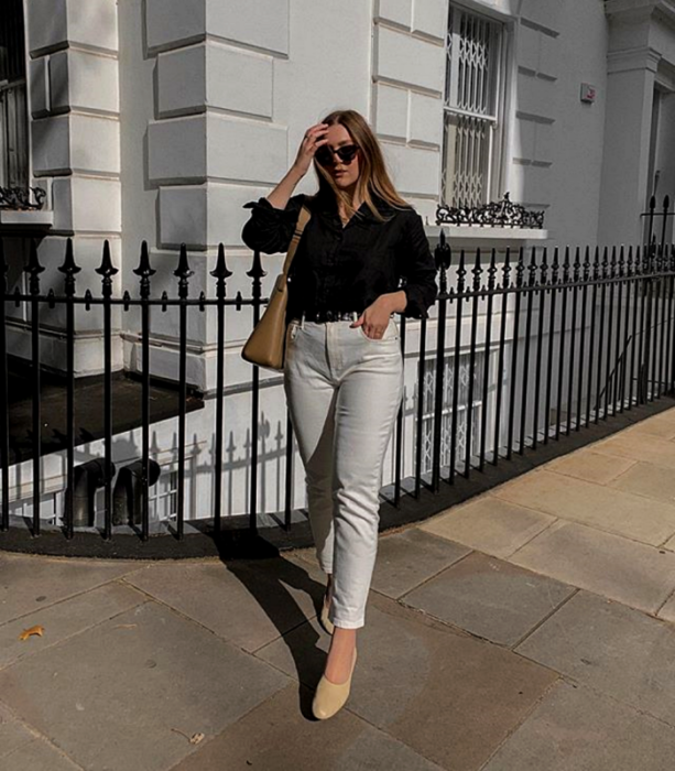 blonde girl wearing sunglasses, black long sleeve shirt, white skinny jeans and beige flats