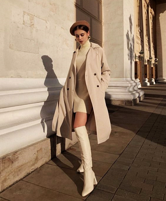 brown haired girl wearing brown beret, beige turtleneck sweater dress, long beige coat, white leather white boots with heel