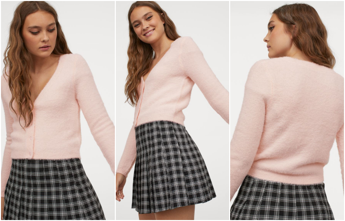 Long light hair girl wearing a pastel pink furry cardigan sweater with a black plaid mini skirt