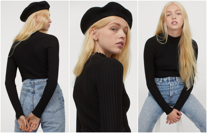 blonde girl wearing a black beret, long sleeve black top and waist jeans