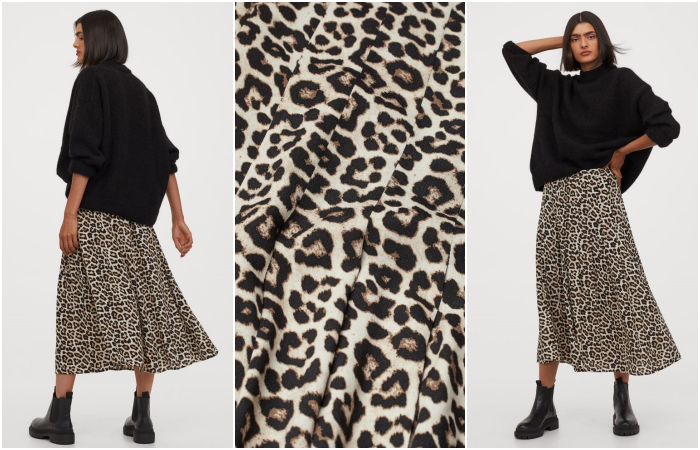 brunette girl wearing black sweater, black sole ankle boots and long skirt with cheetah animal print