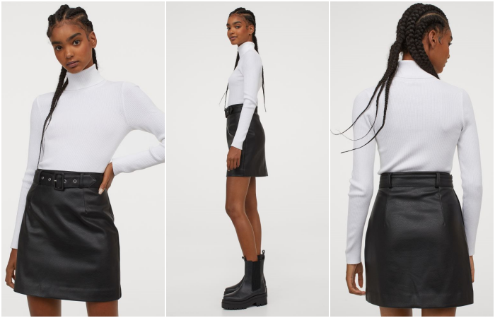 brunette girl wearing white long sleeve top, and high neck, black leather skirt with belt and black ankle boots with black sole