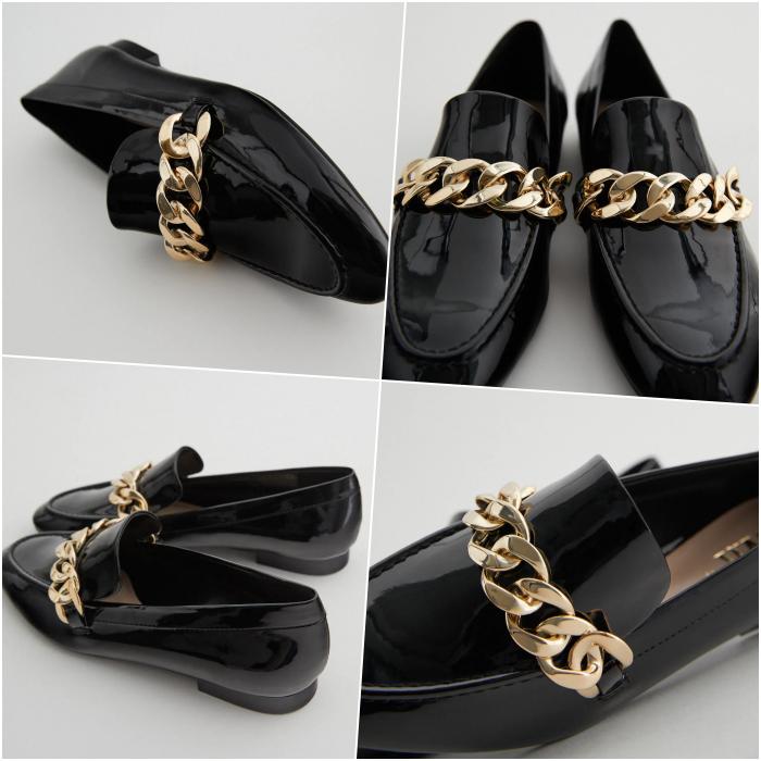 zapatos estilo loafer oxford negros de charol con detalle de cadena dorada en el empeine