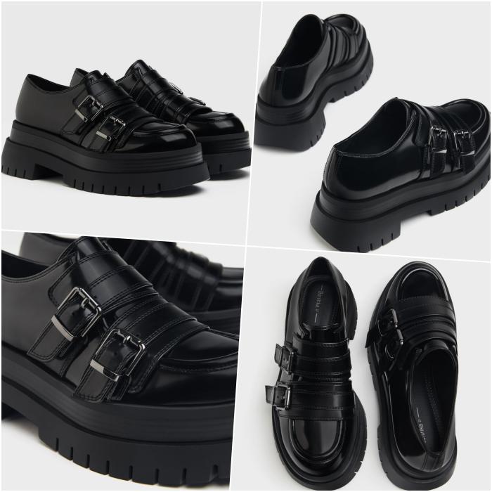 zapatos negros tipo oxford de plataforma gruesa y hebillas grandes